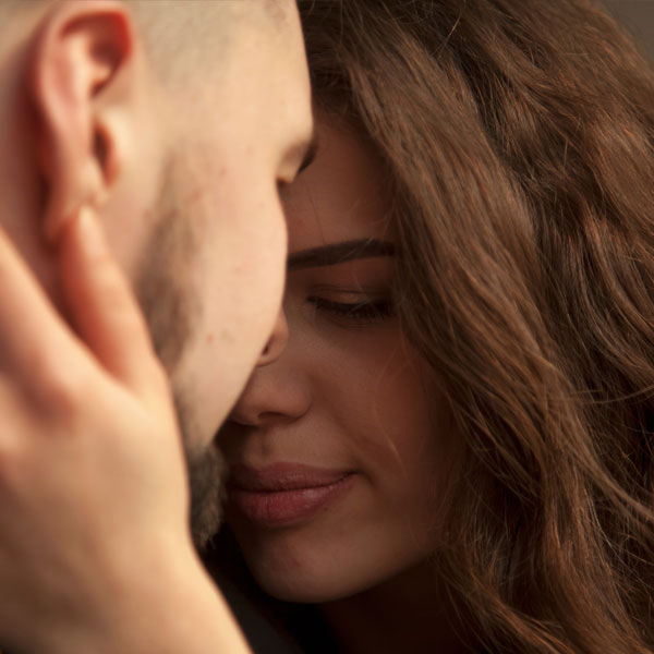 Woman and man in sensual moment